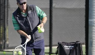 In this Tuesday, Dec. 12, 2017 photo, Ivan Lendl works with young tennis players he coaches at the USTA National Campus in Orlando, Fla. For a couple of years now, in a very under-the-radar sort of way, Lendl has been a part-time scout and teacher for the USTA, identifying _ and then working with _ American kids seen as possible up-and-comers. (AP Photo/John Raoux)