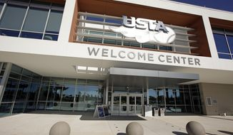 "In this Tuesday, Dec. 12, 2017, photo, the entrance to the welcome center at the USTA National Campus is seen in Orlando, Fla. The aim is to provide anything and everything a tennis player could possibly need. A state-of-the-art gym. A director of performance, Brent Salazar, who used to be the strength and conditioning coach for the NFL's Minnesota Vikings. Nutritionists. A ""mental skills specialist"" (also known as a sport psychologist). Equipment advisors. Help with video analysis and analytics.  ""Anything you can think of, it's pretty much here,"" said Frances Tiafoe, a top-100 player. (AP Photo/John Raoux)"
