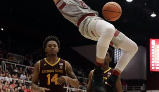 Stanford center Josh Sharma, top, dunks against Arizona State during the second half of an NCAA college basketball game Wednesday, Jan. 17, 2018, in Stanford, Calif. (AP Photo/Marcio Jose Sanchez)
