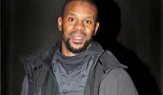 FILE - In this file photo dated Nov. 23, 2015, British former boxing champion Anthony Small. British police said Thursday Jan. 18, 2018, that 36-year old Muslim convert Anthony Small has been charged with encouraging acts of terrorism, after posting a video on social media in September 2016, which they assert violates anti-terrorism laws. (Nick Ansell/PA FILE via AP)