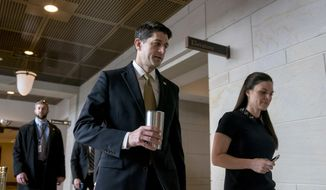 House Speaker Paul Ryan of Wis., center, accompanied by his Press Secretary AshLee Strong, right, walks to the Capitol Building from the Capitol Visitor's Center, Thursday, Jan. 18, 2018, in Washington. (AP Photo/Andrew Harnik)
