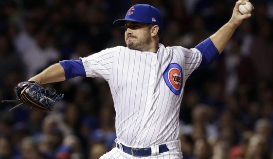 FILE - In this Oct. 18, 2017, file photo, Chicago Cubs relief pitcher Brian Duensing throws during the seventh inning of Game 4 of baseball's National League Championship Series against the Los Angeles Dodgers in Chicago. The Cubs bolstered their revamped bullpen on Wednesday, Jan. 17, 2018, bringing back Duensing with a $7 million, two-year contract. (AP Photo/Matt Slocum, File)