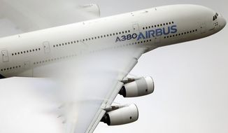 In this June 18, 2015, file photo, vapor forms across the wings of an Airbus A380 as it performs a demonstration flight at the Paris Air Show, Le Bourget airport, north of Paris. Emirates airline said in a statement Thursday, Jan. 18, 2018, that it is purchasing 20 A380 aircraft with the option for 16 more in a deal worth $16 billion, throwing a lifeline to the European-made double-decker jumbo jets. (AP Photo/Francois Mori, File)