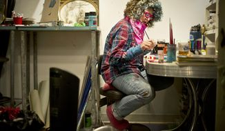 "Local Winona artist, Sarah Johnson, paints at her home studio on Thursday, Jan. 4, 2018. She makes it her goal to ""see how many rainbows"" she can eat in a day. Her breakfast the other morning consisted of orange and yellow carrots, red cabbage, green cauliflower and celery. Her hair is always a different color, and her outfits almost always contain a splash of this and that.   (Chuck Miller/The Winona Daily News via AP)"