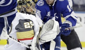 Tampa Bay Lightning left wing Chris Kunitz (14) tries to pick up a rebound after Vegas Golden Knights goaltender Marc-Andre Fleury (29) made a save on a shot during the second period of an NHL hockey game Thursday, Jan. 18, 2018, in Tampa, Fla. (AP Photo/Chris O'Meara)