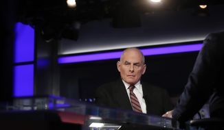 """White House chief of staff John Kelly pauses to look to a video monitor as he appears on Special Report with Bret Baier on Fox News in Washington, Wednesday, Jan. 17, 2018. Kelly says Trump has evolved on many issues since the campaign. Kelly says in an interview with Baier that """"there's been an evolutionary process that this president's gone through"""" on issues ranging from Afghanistan to his promised Southern border wall. (AP Photo/Carolyn Kaster)"""
