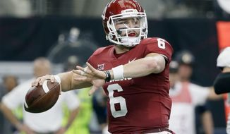 """FILE - In this Dec. 2, 2017, file photo, Oklahoma quarterback Baker Mayfield throws a pass during the first half of the Big 12 Conference championship NCAA college football game against TCU in Arlington, Texas. Mayfield says one of his top priorities as he prepares for the NFL draft is to allay concerns about his character. """"People will have their guesses and their opinions on my character, but anyone that's actually sat down and talked to me knows that I don't have any character issues, any off-the-field issues,"""" Mayfield said Thursday evening, Jan. 18, during a conference call after named the 2017 Manning Award winner. (AP Photo/Tony Gutierrez, File)"""