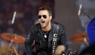 In this Nov. 24, 2016, file photo, country music singer Eric Church performs at halftime during an NFL football game between the Washington Redskins and Dallas Cowboys in Arlington, Texas. (AP Photo/Ron Jenkins, File)