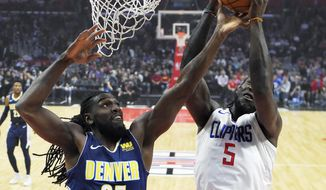 Los Angeles Clippers forward Montrezl Harrell, right, grabs a rebound away from Denver Nuggets forward Kenneth Faried during the first half of an NBA basketball game, Wednesday, Jan. 17, 2018, in Los Angeles. (AP Photo/Mark J. Terrill)