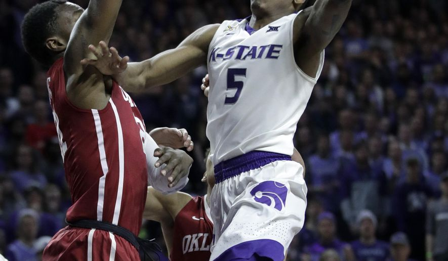Kansas State guard Barry Brown (5) shoots over Oklahoma forward Kristian Doolittle (21) during the second half of an NCAA college basketball game in Manhattan, Kan., Tuesday, Jan. 16, 2018. Kansas State defeated Oklahoma 87-69. (AP Photo/Orlin Wagner)