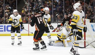 Anaheim Ducks' Adam Henrique (14) celebrates his goal against Pittsburgh Penguins goaltender Tristan Jarry during the second period of an NHL hockey game Wednesday, Jan. 17, 2018, in Anaheim, Calif. (AP Photo/Jae C. Hong)