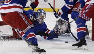 New York Rangers goaltender Henrik Lundqvist (30) makes a save on a shot by the Buffalo Sabres during the first period of an NHL hockey game Thursday, Jan. 18, 2018, in New York. (AP Photo/Julie Jacobson)