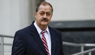 FILE - In this Wednesday, Nov. 18, 2015, file photo, former Massey Energy CEO Don Blankenship leaves the Robert C. Byrd United States Courthouse following the second day of jury deliberation in Charleston, W.Va. Blankenship, who went to prison related to the deadliest U.S. mine disaster in four decades, is kicking off his U.S. Senate campaign with a town hall meeting for voters, on Thursday, Jan. 18, 2018. (AP Photo/Walter Scriptunas II, File)
