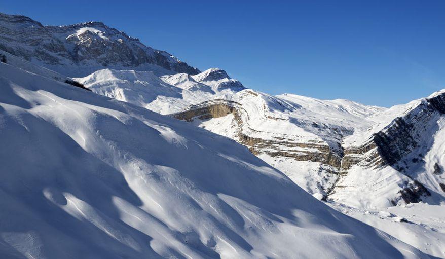Off-piste slope at nice sun evening. Greater Caucasus, Mount Shahdagh. Qusar rayon of Azerbaijan.