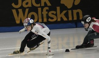 FILE - In this Nov. 18, 2017, file photo, South Korea's Shim Suk-hee, left, competes with Canadas' Kim Boutin during the women's 1,500 meter final race at the ISU World Cup Short Track Speed Skating competition in Seoul, South Korea. South Korea's skating authorities said on Friday, Jan. 19, 2018, they've suspended a national team coach for allegedly beating Olympic short track speed staking champion Shim. (AP Photo/Ahn Young-joon, File)
