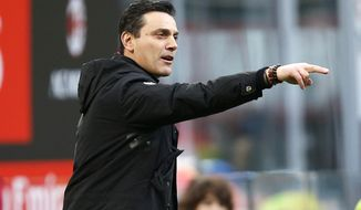 FILE - In this Nov. 26, 2017 file photo, of the then AC Milan coach Vincenzo Montella gives instructions to his players during the Serie A soccer match between AC Milan and Torino at the San Siro stadium in Milan, Italy.  Vincenzo Montella now the Sevilla coach is positive Sevilla got the win it needed to turn its fate around in the Spanish league. The newly arrived Italian coach said the 2-1 come-from-behind victory at Atletico Madrid in the Copa del Rey quarterfinals will allow Sevilla to get back on track and end its slump in the league. (AP Photo/Antonio Calanni, file)