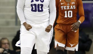 In this Jan. 10 2018, photo, TCU forward Amy Okonkwo (00) celebrates after blocking a shot as Texas guard Lashann Higgs (10) watches during an NCAA college basketball game in Fort Worth, Texas. After the TCU women had pulled off what many would consider a huge upset over Top 10 team Texas, top scorer Okonkwo and the Horned Frogs went back to work and did it again. (AP Photo/Tony Gutierrez)