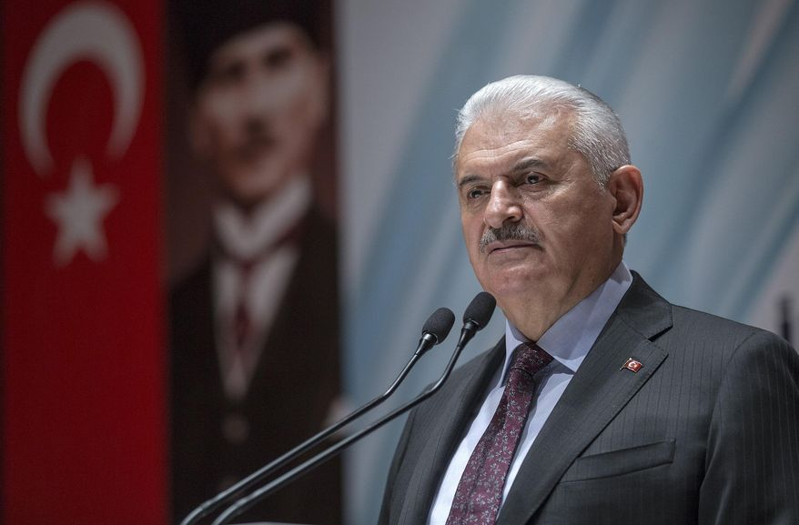 Turkey's Prime Minister Binali Yildirim speak to the country's security chiefs in Ankara, Turkey, Thursday, Jan. 18, 2018. Yildirim on Thursday complained about inconsistent statements from the United States concerning the creation of a border secruty force in northern Syria, saying Washington has to put an end to the confusion and stand by Turkey. (Pool Photo via AP)
