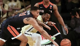 Virginia forward Isaiah Wilkins (21) and Georgia Tech guard Josh Okogie (5) battle for a loose ball during the first half of an NCAA college basketball game Thursday, Jan. 18, 2018, in Atlanta. (AP Photo/John Bazemore)