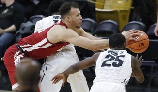 Washington State forward Drick Bernstine, center, reaches out for the ball between Colorado guards Namon Wright, back, and McKinley Wright IV in the first half of an NCAA college basketball game Thursday, Jan. 18, 2018, in Boulder, Colo. (AP Photo/David Zalubowski)