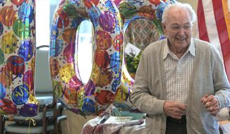 In a Friday, Jan. 12, 2018 photo, Lloyd Clement attends his 100th birthday party, in North Logan, Utah. (Eli Lucero/The Herald Journal via AP)