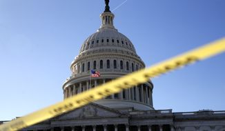 Police tape marks a secured area of the Capitol, Friday, Jan. 19, 2018, in Washington, as a bitterly-divided Congress hurtles toward a government shutdown this weekend. (AP Photo/Jacquelyn Martin)