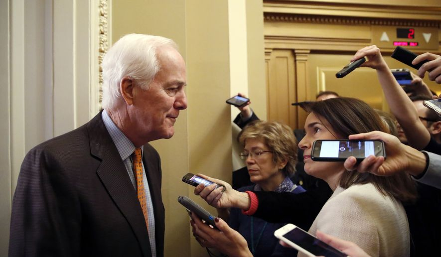Senate Majority Whip Sen. John Cornyn, R-Texas, talks with reporters outside his office on Capitol Hill, Friday, Jan. 19, 2018 in Washington. (AP Photo/Alex Brandon)