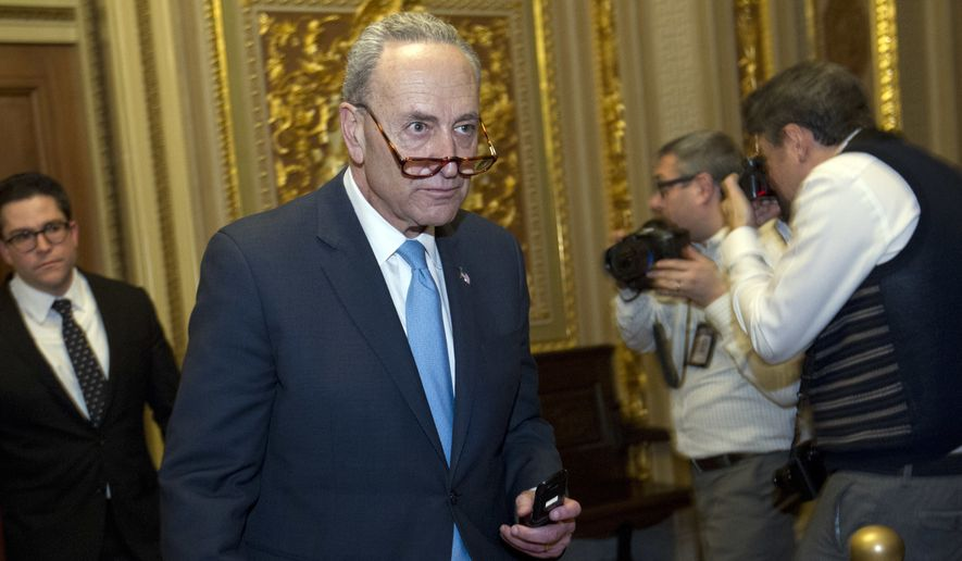 Sen. Charles Schumer, D-N.Y., walks to the chamber after a closed meeting with fellow democrats on Capitol Hill, Friday, Jan. 19, 2018, in Washington. (AP Photo/Jose Luis Magana)