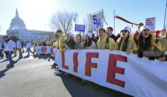 People participate in the March for Life on Capitol Hill in Washington, Friday, Jan. 19, 2018. (AP Photo/Susan Walsh) ** FILE **
