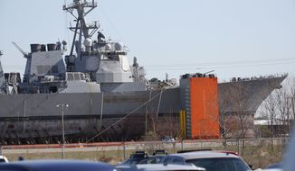 The repairs to the damaged starboard of the USS Fitzgerald can be seen at Ingalls Shipbuilding, a naval shipyard run by Virginia-based Huntington Ingalls Industries, in Pascagoula, Miss., Friday, Jan. 19, 2018. Once it is placed in a repair berth, the remainder of the repairs, overhaul and modernization will take place. (AP Photo/Rogelio V. Solis)