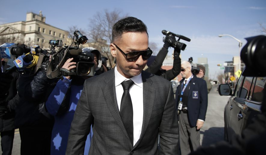 """Michael """"The Situation"""" Sorrentino, one of the former stars of the """"Jersey Shore"""" reality TV show, is swarmed by reporters while leaving the Martin Luther King, Jr., Federal Courthouse after a hearing, Friday, Jan. 19, 2018, in Newark, N.J. Sorrentino pleaded guilty to one count of tax evasion and admitted concealing his income in 2011 by making cash deposits in amounts that wouldn't trigger federal reporting requirements. He and his brother, Marc, were charged in 2014 and again last year with multiple counts related to nearly $9 million in income from the show. (AP Photo/Julio Cortez)"""