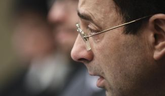 A tear falls from Larry Nassar's eye Friday, Jan. 19, 2018, as he is confronted  in Circuit Judge Rosemarie Aquilina's courtroom during the fourth day of victim impact statements regarding former sports medicine doctor Larry Nassar, who pled guilty to seven counts of sexual assault in Ingham County, and three in Eaton County. (Matthew Dae Smith /Lansing State Journal via AP)