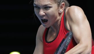 Romania's Simona Halep makes a backhand return to United States' Lauren Davis during their third round match at the Australian Open tennis championships in Melbourne, Australia, Saturday, Jan. 20, 2018. (AP Photo/Vincent Thian)
