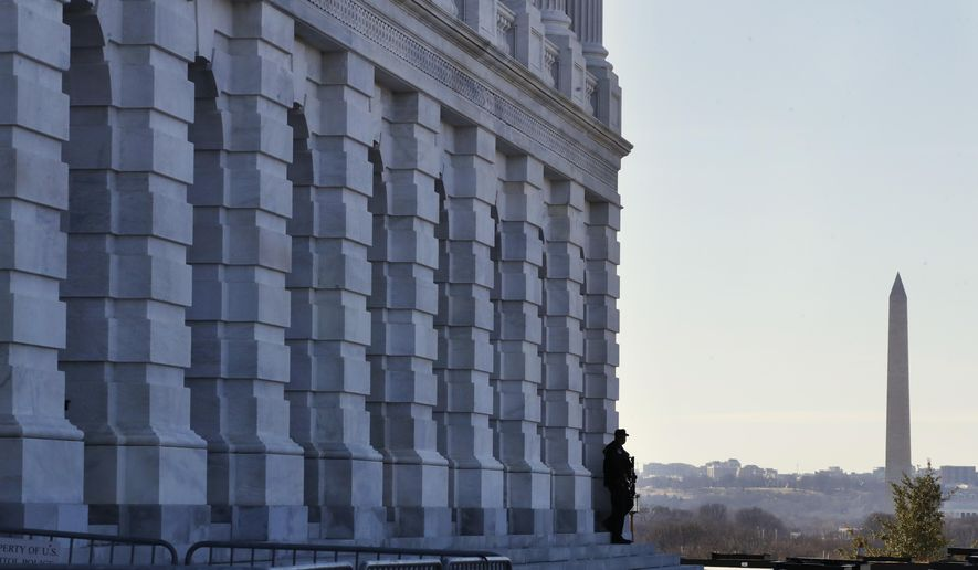 As a bitterly-divided Congress hurtles toward a government shutdown this weekend, a Capitol Police officer guards his post, Friday, Jan. 19, 2018, on Capitol Hill in Washington. (AP Photo/Jacquelyn Martin)