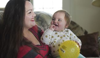 In this Thursday, Jan. 11, 2018 photo, Victoria Williams shares a laugh with her daughter, Victoria Hernandez, 1, at their residence in Nampa, Idaho. If you had met Williams a few years ago, you would not recognize her as the woman she is today. (Chris Bronson/The Idaho Press-Tribune via AP)