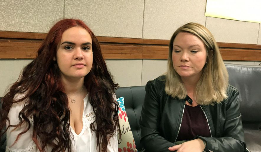 In this undated photo, Jesse Musco, left, sits with her mother, Lori, at Brookdale Community College, where Jesse is attending a high school program for students in addiction recovery, in Middletown, N.J. (Amanda Oglesby /The Asbury Park Press via AP)