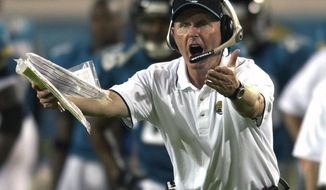 FILE - In this Nov. 25, 2001, file photo, Jacksonville Jaguars coach Tom Coughlin argues a call with officials in the third quarter of an NFL football game against the Baltimore Ravens, in Jacksonville, Fla. It's no exaggeration to say Tom Coughlin built the Jaguars from the ground up. It's also no exaggeration to say Coughlin's last piece of unfinished business would be bringing a Super Bowl title to the town he helped put on the map. (AP Photo/Scott Audette, File)