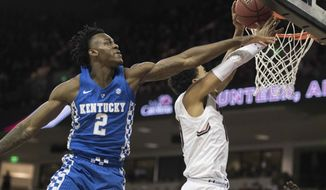Kentucky forward Jarred Vanderbilt (2) challenges a shot by South Carolina forward Justin Minaya, right, during the second half of an NCAA college basketball game Tuesday, Jan. 16, 2018, in Columbia, S.C. South Carolina defeated Kentucky 76-68. (AP Photo/Sean Rayford)