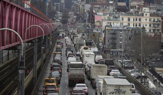 FILE - In this Jan. 11, 2018 file photo, traffic crosses the Williamsburg Bridge in New York from Brooklyn into Manhattan. Motorists would have to shell out $11.52 to drive into the busiest parts of Manhattan under a new proposal commissioned by Democratic Gov. Andrew Cuomo to ease traffic congestion and raise vital funds for mass transit. Trucks would pay even more, $25.34, while taxi cabs, Uber rides and for-hire vehicles would be charged between $2 and $5 per ride. (AP Photo/Mary Altaffer, File)