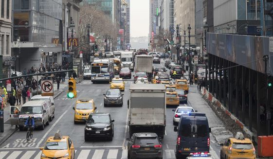 In this Jan. 11, 2018 file photo, traffic makes its way across 42nd Street in New York City. (AP Photo/Mary Altaffer, File)  **FILE**