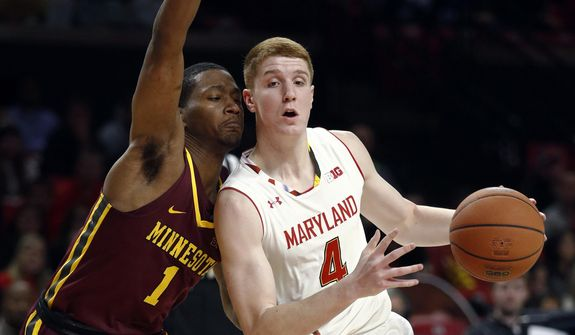 Maryland guard Kevin Huerter, right, drives to the basket past Minnesota guard Dupree McBrayer duringp the second half of an NCAA college basketball game in College Park, Md., Thursday, Jan. 18, 2018. Huerter contributed a team-high 19 points to Maryland's 77-66 win. (AP Photo/Patrick Semansky) ** FILE **