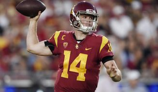 FILE - In this Oct. 14, 2017, file photo, Southern California quarterback Sam Darnold passes the ball during the first half of an NCAA college football game against Utah, in Los Angeles. Quarterbacks Sam Darnold, Lamar Jackson and Josh Rosen are among the record 106 underclassmen given special entry to the NFL draft, making it four of the last five seasons in which at least 95 players have declared early. The NFL released Friday, Jan. 19, 2018, the official list of college players who have requested early entry.  (AP Photo/Kelvin Kuo) ** FILE **