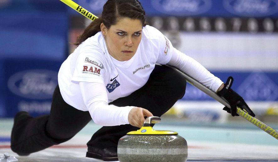 FILE - In this March 23, 2017, file photo, United States' Becca Hamilton releases the stone during a match against Switzerland in the Women's World Curling Championship in Beijing.  No one will work longer hours at the Pyeongchang Olympics than American curlers Matt and Becca Hamilton.By qualifying for both the new mixed doubles discipline and the traditional, single-gender curling event, the siblings from McFarland, Wisconsin, could be on the ice for as many as 50 hours _ by far the longest anyone will be in live competition at the Winter Games. (AP Photo/Mark Schiefelbein, File)