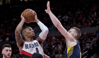 Portland Trail Blazers guard Damian Lillard shoots over Indiana Pacers center Domantas Sabonis during the second half of an NBA basketball game in Portland, Ore., Thursday, Jan. 18, 2018. The Trail Blazers won 100-86. (AP Photo/Craig Mitchelldyer)