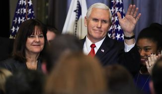 Vice President Mike Pence with his wife Karen Pence, left, waves to anti-abortion supporters and participants of the annual March for Life event, during a reception in the Indian Treaty Room at the Eisenhower Executive Office Building on the White House complex in Washington, Thursday, Jan. 18, 2018. (AP Photo/Manuel Balce Ceneta)
