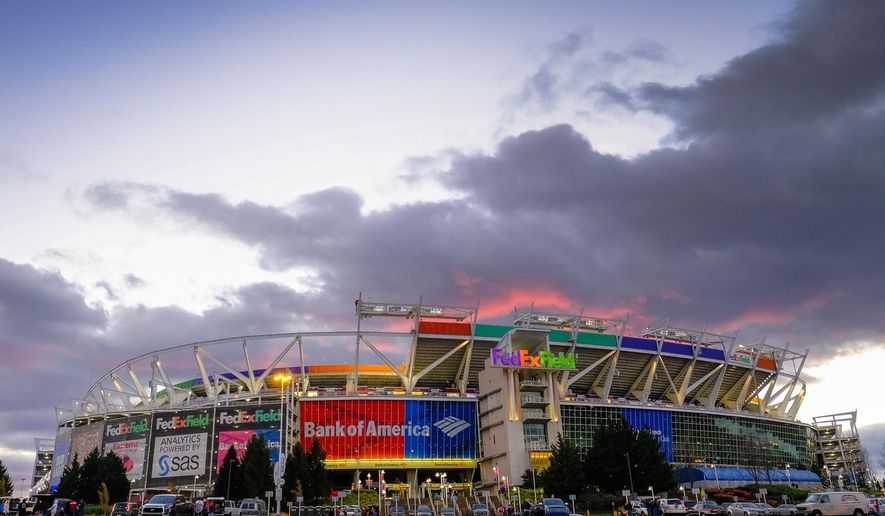 FILE - In this Nov. 20, 2016 file photo, the sun sets behind FedEx Field before an NFL football game between the Washington Redskins and the Green Bay Packers in Landover, Md. Three politicians in Maryland, Virginia and the District of Columbia are teaming up across partisan lines to try and prevent their governments from waging a bidding war with public money to build a new stadium for the Washington Redskins.  The liberal Democrat in Maryland, conservative Republican in Virginia and left-leaning independent District of Columbia Council member have introduced legislation to set up an interstate compact barring any public spending on incentives for a new stadium. The current lease at FedEx Field in suburban Maryland ends in 2027 and the team is exploring new potential locations.   (AP Photo/J. David Ake, File)