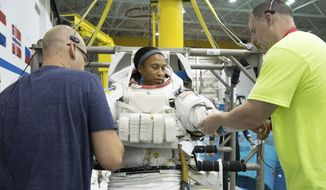 In this Sept. 16, 2014, file photo provided by NASA, astronaut Jeanette Epps participates in a spacewalk training session at the Johnson Space Center in Houston. In June 2018, Epps was supposed to be the first African-American to live on the International Space Station, but on Thursday, Jan. 18, 2018, NASA announced it was pulling her off the mission for undisclosed reasons. (Robert Markowitz/NASA via AP)