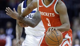 Houston Rockets guard Chris Paul (3) tangles with Minnesota Timberwolves guard Jeff Teague (0) as he pivots during the first half of an NBA basketball game Thursday, Jan. 18, 2018, in Houston. (AP Photo/Michael Wyke)