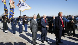 President Donald Trump, joined by Defense Secretary Jim Mattis, left, and Vice President Mike Pence, speaks to the media as he arrives at the Pentagon, Thursday, Jan. 18, 2018. (AP Photo/Pablo Martinez Monsivais)