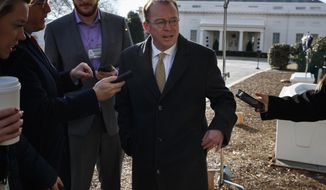 Director of the Office of Management and Budget Mick Mulvaney speaks with reporters outside the White House about a possible government shutdown, Friday, Jan. 19, 2018, in Washington. (AP Photo/Evan Vucci)